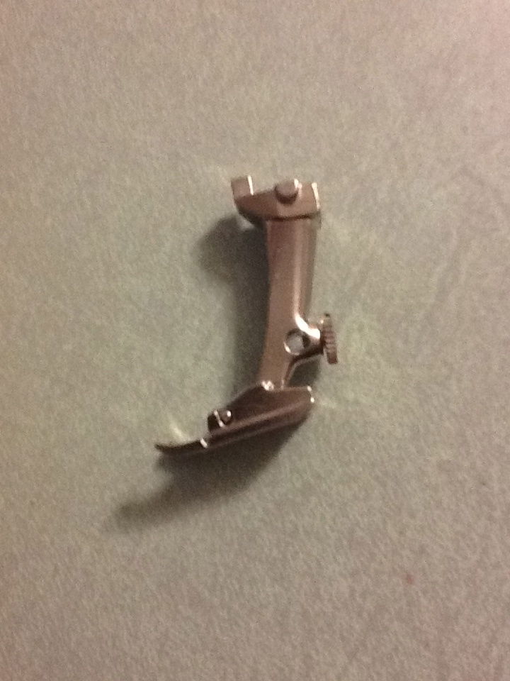 This is a full shank foot.  It has a hole at the top of the foot that you match with the machine then you pull down a clasp and you are ready to go!  NO MORE SCREWS!